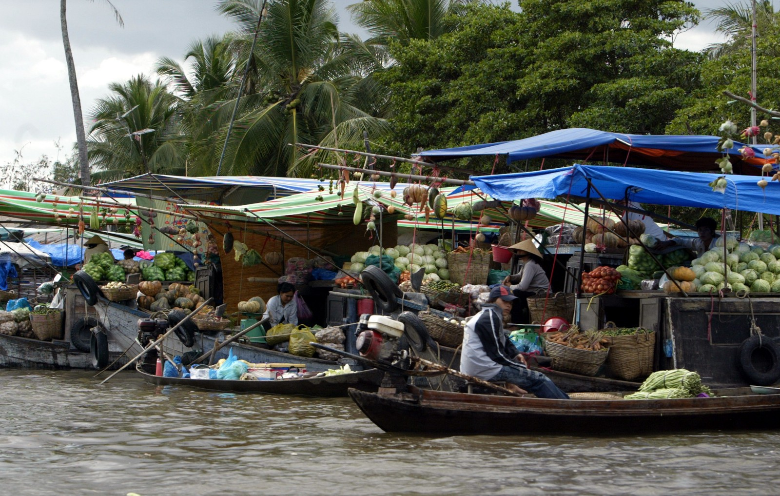 Boats loaded with fruits and vegetables on the Mekong river.