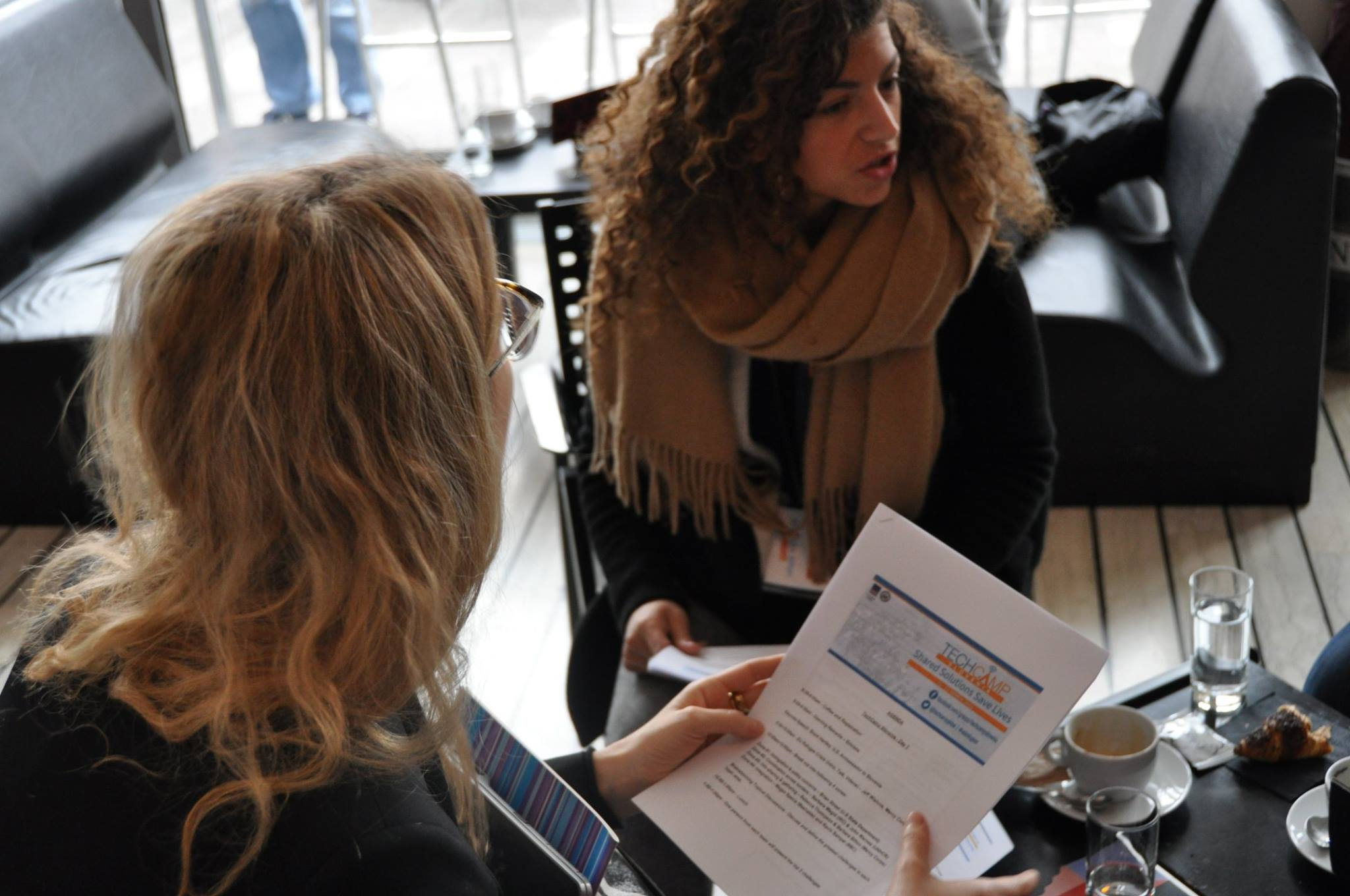 TechCamp Slovenia participants discuss the technology workshop's agenda.