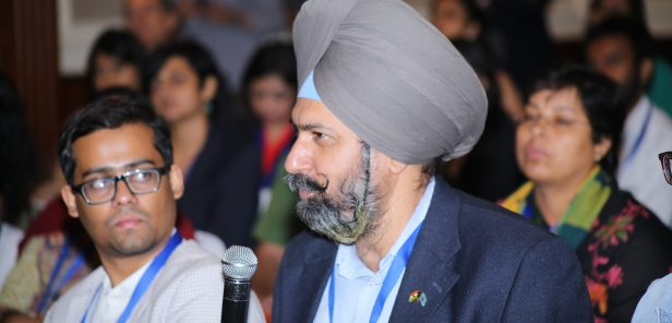 A participant at TechCamp India shares with other members of the workshop.