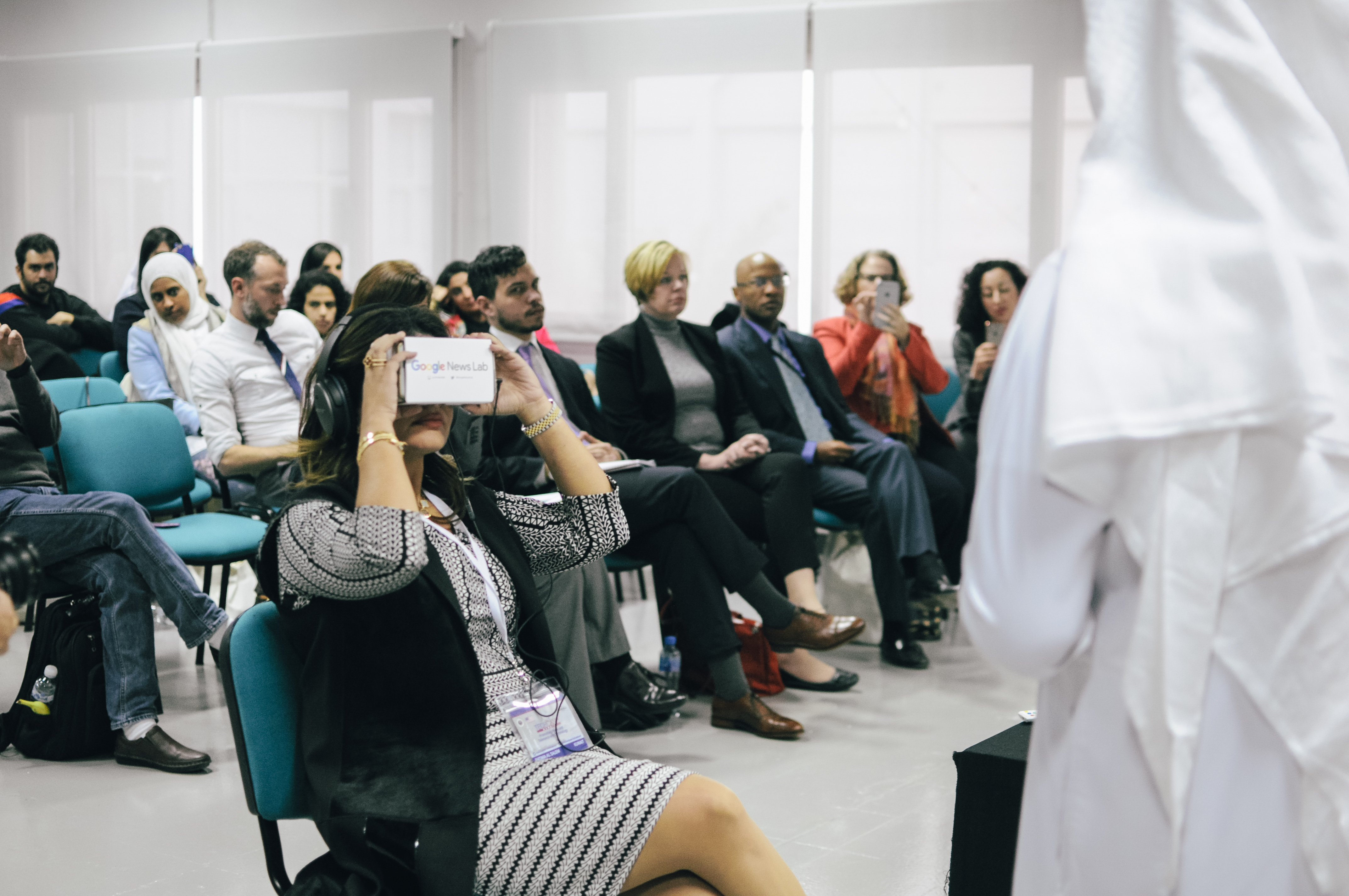 A TechCamp Kuwait trainer participates in a Virtual Reality demonstration meant to invoke empathy for Syrian refugees.