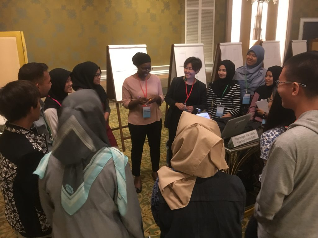 Jamila helps her group brainstorm challenges