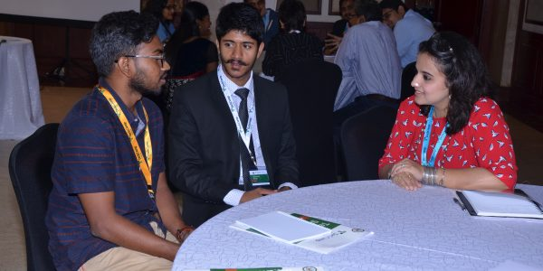Dr. Suchi Gaur speaks with two participants at TechCamp Chennai.